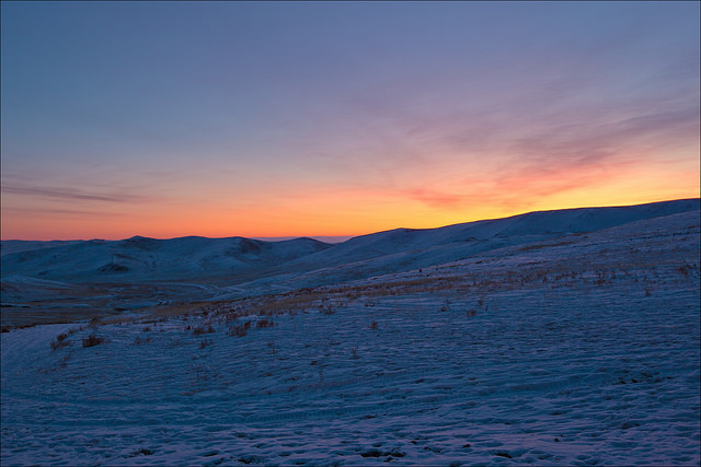 sunrise on the snowy steps of mongolia
